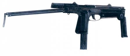 PM-63 submachine gun with front grip and buttstock opened for better control during fire; slide is cocked and gun is ready to fire.