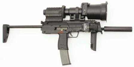 HK MP7A1 submachine gun / personal defense weapon with extended 40-roundmagazine and a number of extras, including night sight, flashlight and silencer.