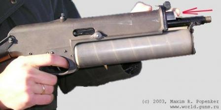 The most weird feature of PP-90M1 is its charging system, which is made as abutton, located just above the muzzle. It had to be pressed with the finger (see arrow) to cock the gun. Not the safest way, if anyone will ask me.