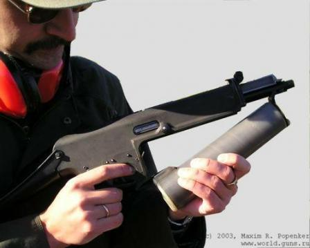 Yours truly demonstrates the magazine change procedure. The magazine catch islocated at the front of the triggerguard.