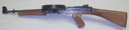 American-180 submachine gun with 176-round drum, left side view.
