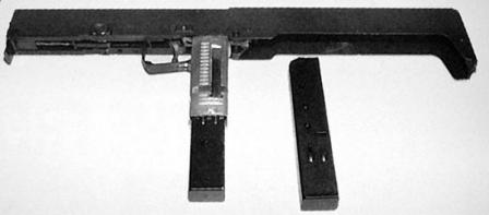 Original Ares FMG folding submachine gun, shown opened and with spare magazine.