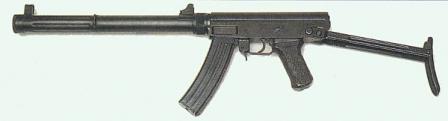 Yerinde dergi ile 64 susturuldu makineli tabanca, sol boyutunu yazın.  Not thatsafety / yangın Vites kolu silah iki tarafında yineleniyor.