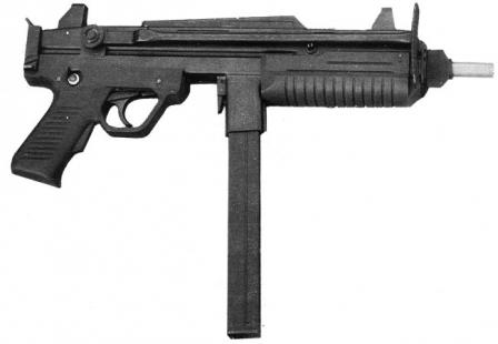 Benelli CB-M2 submachine gun, with butt folded. Note the ejection port visible between the trigger guard and magazine housing.