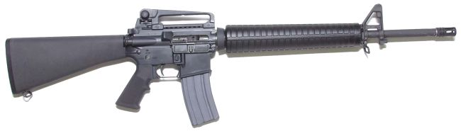 M16A4 rifle with 30-round magazine and carrying handle installed over the Picatinny rail, right side