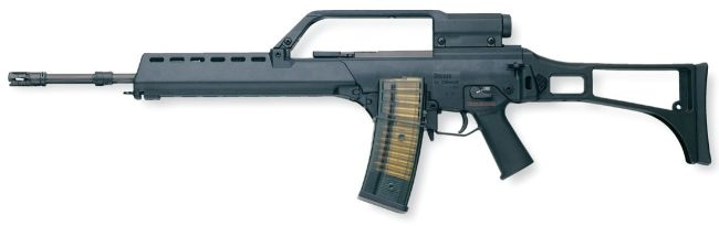 HK G36E rifle (Export version) with single 1.5X telescope sight and spare magazine clamped to the left side of the inserted one.