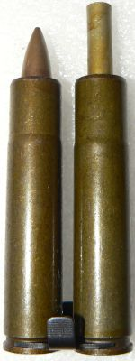loaded 7.62mm PZAM silent cartridge and fired case (note projecting piston and slightly bottlenecked cartridge) loaded into steel clip, as used for S4M pistol