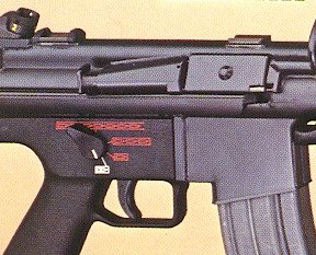 close-up view to the G41 receiver with dust cover, forward assist button and STANAG magazine veil