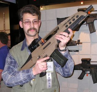 Author of this website is posing with XM8 at the ShotShow-2004, Las Vegas,USA.