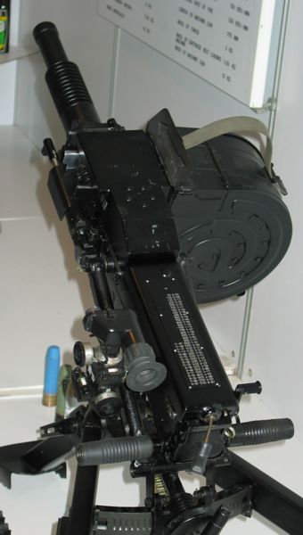 Close-up view on the receiver of AGS-17. Clearly visible are dual grips, opticalsights, ballistic table (printed on the receiver top cover) and charging handle(hanging on the short steel cable from the rear of the receiver).