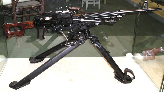 Original Kalashnikov PKS (PK on tripod) machine gun; note partially fluted barrel and long flash hider.