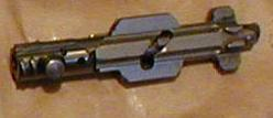 MG-34 bolt; note interrupted threads locking lugs at the bolt head (left), and studs used to rotate it (just behind threads).