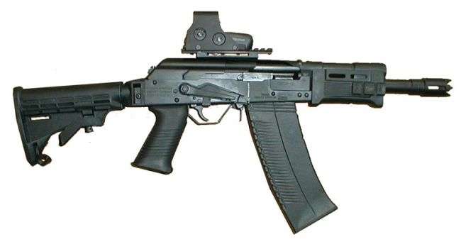 Saiga 12 shotgun heavily modified by tromix in usa to their 8