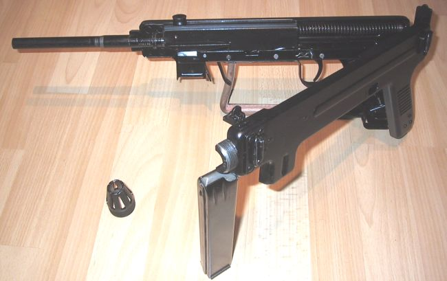 Madsen model 1950 submachine gun; receiver is partially opened for disassembly.