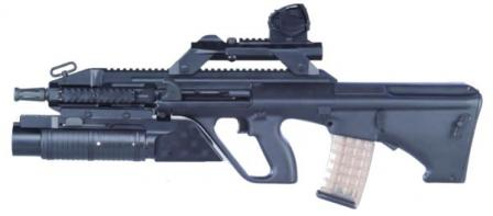 Steyr AUG A3 Carbine with 16inch barrel and special 40mm grenade launcher; grenade launcher sight is attached to the top of removable telescopic riflesight
