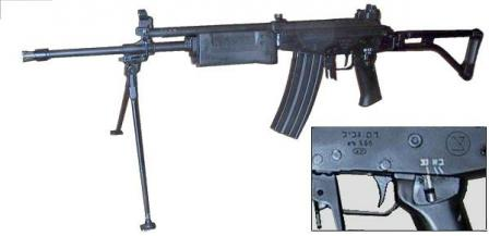 The same rifle, with bipods unfolded. Insert shows the left-side fire selector /safety switch with Hebrew markings