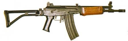 Galil SAR 5.56mm with shorter barrel ( and older type brownish color wooden forearm)