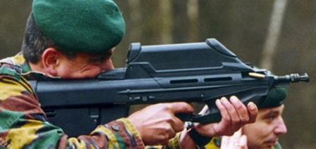 FN F2000 rifle being fired by Belgian soldier. Note spent case emerging from theport at the front of the rifle