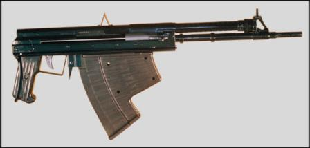 APS rifle, with butt collapsed; note crude non-adjustable iron sights and unusual magazine