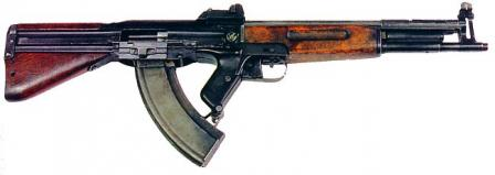 KB-408 is gas operated, locked breech weapon that uses vertically tilting bolt to lock the barrel. Cocking handle is located at the left side of the weapon,above the wooden handguard; it does not reciprocate when gun is fired.