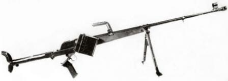 Pz.B.39 antitank rifle, with spare ammunition box attached to the gun. The pistol grip is dropped down to open the breech for reloading.