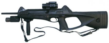 Beretta CX4 Storm carbine accessorized with optional Picatinny rails, forward grip, red-dot sight and tactical light.