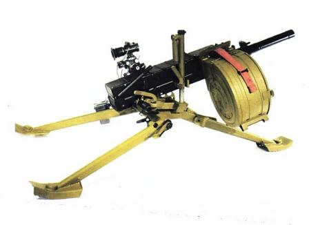 AGS-30 automatic grenade launcher on standard tripod; the vertical projection installed on tripod at the right side hosts folding carrying handle which allows to haul the weapon over the battlefield in ready to fire position.