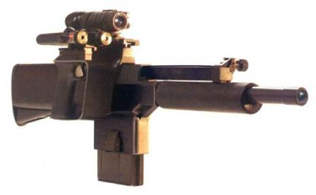 PAW-20 with night vision sight and laser pointer. Note that magazine projectswell below its housing.