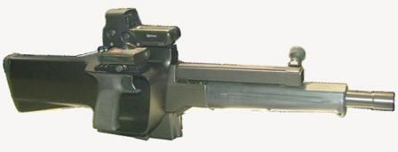PAW-20 grenade launcher, right side. Note that it has dual Picatinny rails whichhost collimating (red dot) sight at left, and a laser pointer at right.