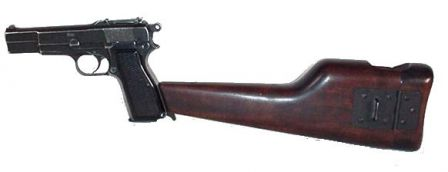 Browning High Power, also made by Inglis, but with tangent ajustable rear sights and attached holster/shoulder stock.