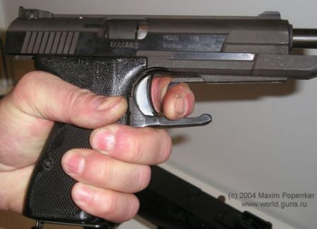 NORINCO Model 77B pistol, showing its single hand slide cycling capability (using front of the trigger guard).