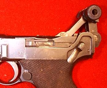 A view to proprietary Lugers' locking mechanism - the breechblock is at the rearmost position.