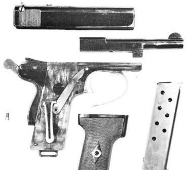 Webley Scott automatic pistol, cal.9mm Browning Long, model of 1909 partially disassembled. The V-shaped return spring and the rocking lever, which connects spring to the slide, are clearly visible on the right side of the grip. Right grip panel is removed.