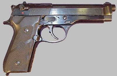 Beretta 92SB - with slide mounted safety and plastic grip panels.