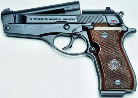 Beretta model 86, 9mm Short, tip-up barrel is opened.
