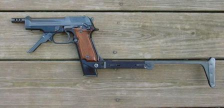 Beretta 93R pistol, with front grip unfolded and shoulder stock attached.