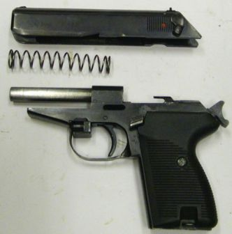P-83 pistol, field stripped.