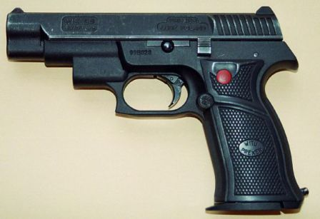 WIST-94L pistol with integral laser aiming module, built into the hump in front of the trigger guard. Red button on the left grip panel turns the laser on when pressed.