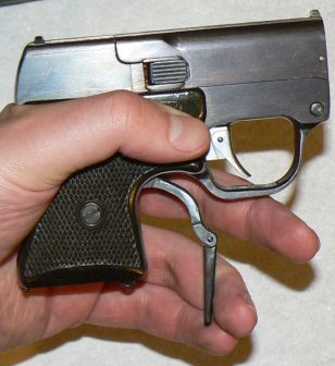 Cocking the internal hammers of the MSP pistol