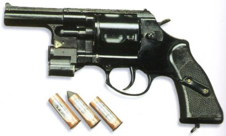 "OTs-20 ""Gnom"" revolver with laser aiming module at the front of the frame and sample rounds of ammunition"