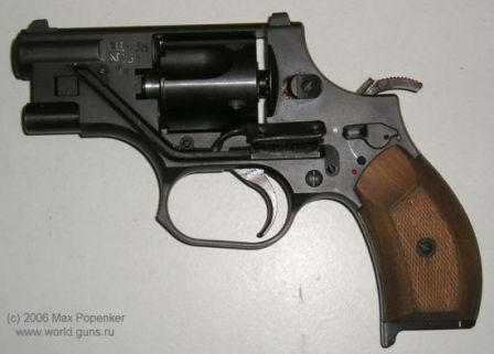 OTs-38 revolver, left side. Note that hammer is cocked and locked by manual safety. The button that controls built-in laser sight is visible above the trigger guard.