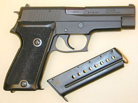 Early SIG-Sauer P220 pistol in 9mm, right side view.