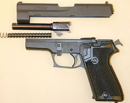 Early 9mm SIG-Sauer P220 pistol partially disassembled.