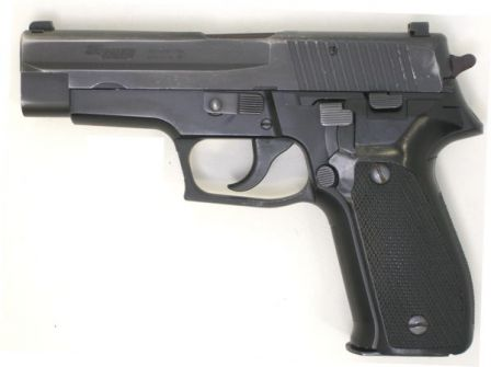 Original (early production) SIG-Sauer P226 pistol in 9mm, with stamped slide, left side view.