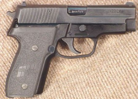 SIG-Sauer P228 pistol, right side.