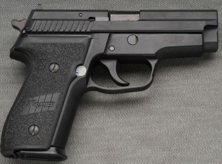 SIG-Sauer P229 pistol, right side.