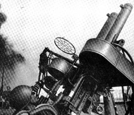Twin AA mount with Browning M2 water-cooled machine guns in action.