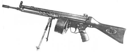 Early production 5,56x45mm HK 13light machine gun with 100-round double drum magazine.