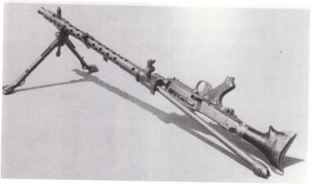 MG-34, barrel change; see how receiver is swung out to the right.