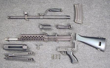 Stoner 63A weapon in magazine-fed light machine gun, partially disassembled.